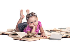 Hard to study. Tired preschooler girl lying on books isolated on white Stock Image