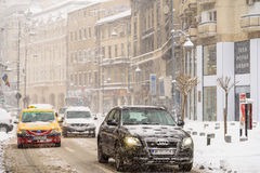 Hard Traffic During Winter Snow Storm In Downtown Bucharest City Stock Photo
