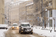 Hard Traffic During Winter Snow Storm In Downtown Bucharest City Royalty Free Stock Photo