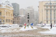 Hard Traffic During Winter Snow Storm In Downtown Bucharest City Stock Image
