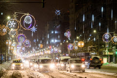Hard Traffic During Winter Snow Storm In Downtown Bucharest City. BUCHAREST, ROMANIA - JANUARY 08, 2017: Hard Traffic During Winter Snow Storm In Downtown stock image