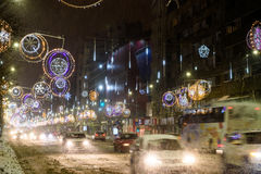 Hard Traffic During Winter Snow Storm In Downtown Bucharest City. BUCHAREST, ROMANIA - JANUARY 08, 2017: Hard Traffic During Winter Snow Storm In Downtown royalty free stock photography