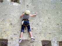 Hard wall. Climbing girl on the wall, hard training Royalty Free Stock Images