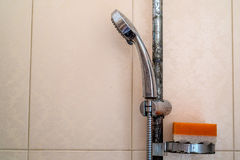 Hard water deposit and rust on shower tap. Hard water calcium deposit and corrosion on chrome shower tap stock images