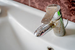 Hard water deposit on a tap. Hard water calcium deposit on chrome tap royalty free stock photography
