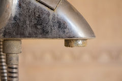 Hard water deposit on a tap. Hard water calcium deposit on chrome tap stock images