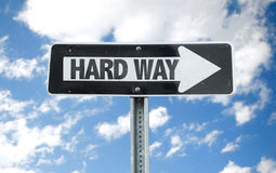 Hard Way direction sign with sky background royalty free stock image
