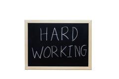 HARD WERKEN geschreven met wit krijt aan bord Stock Foto