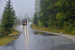 Hard winter traffic. On wet mountain road stock photos