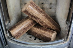 Hard wood briquettes in stove Royalty Free Stock Photos