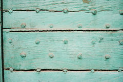 Hard wood door. A door painted green can used as a background Royalty Free Stock Photography