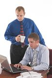 Hard work. Two businessmen during the meeting over white Stock Image