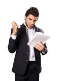 Hard work. A young businessman, hard work and read paper Stock Images