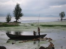 Hard work. Villagers on the boat Royalty Free Stock Image