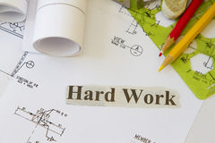 Hard work. Abstract with engineering works and tools Stock Photography