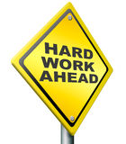 Hard work ahead. Yellow warning road sign, tough job be ambitious even if you have a difficult challenging task with impact to finish. ambition to meet the Royalty Free Stock Images