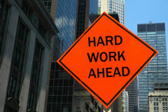 Hard Work Ahead. An orange street sign that reads Hard Work Ahead Royalty Free Stock Photography