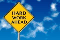 Hard Work Ahead traffic sign. On a sky background royalty free stock photo
