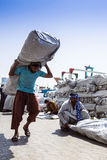 Hard work, Dubai. A lot of foreigners from Asia has been working in Dubai,  as laborers Stock Photo