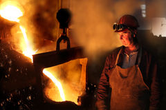 Hard work in a foundry. Melting iron Royalty Free Stock Images