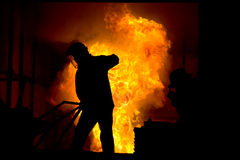 Hard work in a foundry, melting iron Royalty Free Stock Images