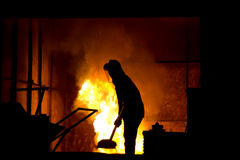 Hard work in a foundry, melting iron. Stock Photo - Hard work in a foundry, melting iron Royalty Free Stock Images