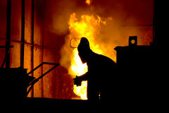 Hard work in a foundry, melting iron Royalty Free Stock Image