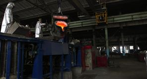 Hard work in the foundry. Pouring molten steel. Liquid steel pouring. stock video footage