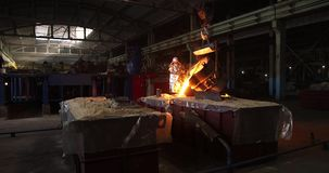 Hard work in the foundry. Pouring molten steel. Liquid steel pouring.