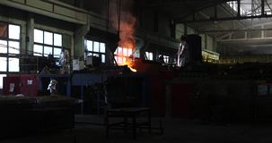 Hard work in the foundry. Pouring molten steel. Liquid steel pouring. stock footage
