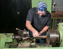 Hard at work in a machine shop. Stock Image