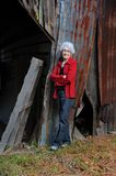 Hard Work Never Hurt Anyone. Elderly woman poses besides her old barn. She is ninety seven years old, and still spry and agile. She exhibits a hard work ethic royalty free stock photography