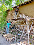 Hard work while restoring a house in a traditional manner Royalty Free Stock Image