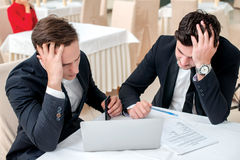 Hard work. Two successful and confident businessman sitting at t Royalty Free Stock Images