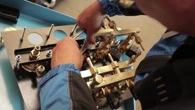 Hard work wiht machine. Man and work in factory stock video footage