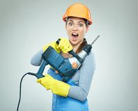 Hard work of woman builder with drill tool. Emotional isolated portrait Stock Photos