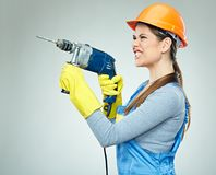 Hard work of woman builder with drill tool. Emotional isolated portrait Royalty Free Stock Photos