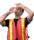 Hard Worker. A thirsty city worker is having a drink from a bottle of water, isolated against a white background Stock Photography