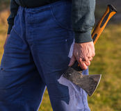 Hard worker with an ax Stock Photo