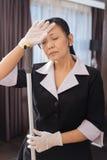 Hard working Asian chambermaid closing her eyes Stock Photo