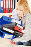 Hard working blond woman Stock Photography
