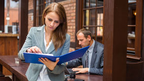 Hard working boss with his secretary. Royalty Free Stock Images