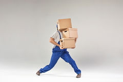 Hard-working builder holding paper boxes Stock Images