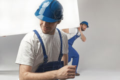 Hard-working builders during the renovation Royalty Free Stock Images