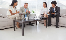 Hard working business people sitting down Royalty Free Stock Photography