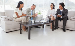 Hard working business people sitting down Royalty Free Stock Photo