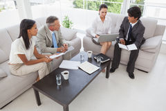 Hard working business people sitting down Stock Photography