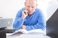 Hard working businessman at the office Royalty Free Stock Photography