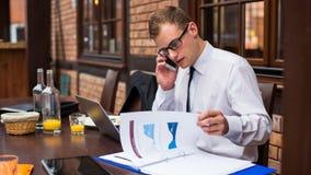 Hard working businessman in restaurant. stock photos