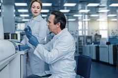 Hard working intelligent researcher working in the medical lab. Medical testing. Hard working intelligent male researcher working in the medical lab and doing a Royalty Free Stock Image